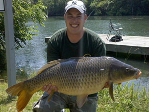 Owner and Club Director Jason Bernhardt with a 32 lbs, 5 oz Common Carp taken in Seneca County,  June 2010