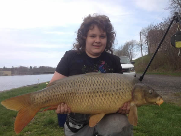 Nathaniel holding Don Knowles' 29.13 lb common caught during session 1 of the Wild Carp Club of Central Fish.