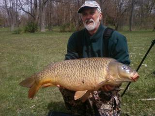 Joe Rinaldo Jr with a 30 lb, 9 oz common carp caught during