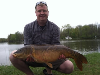 Scott Titus with a 20.5 lb mirror carp caught during