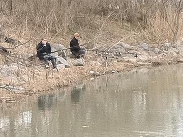 From left) Josh Carnright and Jamie Godkin found a quiet spot along the stream leading into the Inner Harbor.