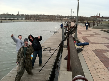 (From left) Sean Lehrer, Paul Russell and Matt Broekhuizen make the best of a slow night at the Syracuse Inner Harbor.