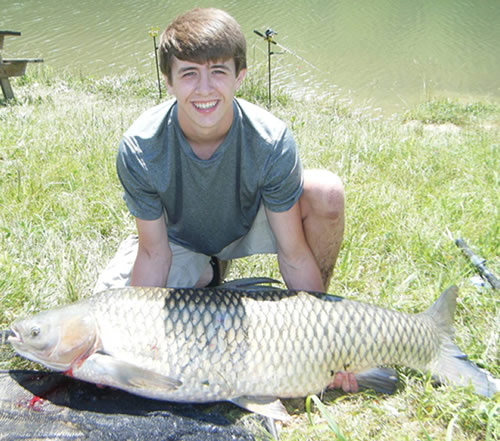 Wyatt Cantrell set a new Wild Carp Club record for largest fish at a club event with his 61 lb, 9 oz grass carp caught during session 5 of the 2013 season of the Wild Carp Club of the Virginias