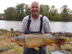Duke Strache with one of his Big 4 Carp. Strache and Virginia released several 20 pounders during day 2 of competition which did not improve their Big 4 to that point