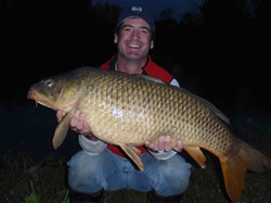 Paul Russell stole 1st place for Big Fish in the 2010 Wild Carp Fall Qualifier--from his teamate Sean Lehrer--with this 24 lb, 14 oz Common caught at 656 PM of day 2, about 30 minutes from conclusion of the event.