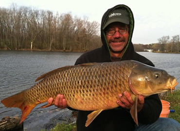 Bill Markle with a 23 lb, 0 oz common carp caught during the November 12, 2011 Shootout in Liverpool, NY