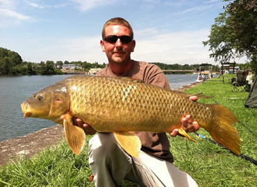 Chris West with a 16 lb, 3 oz common carp caught during the August 13, 2011 Shootout in Fulton, NY