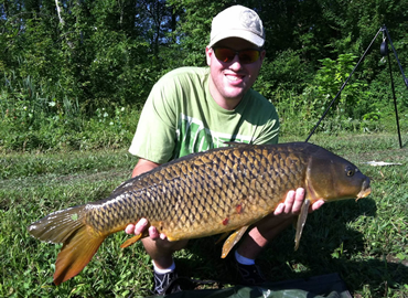 Matt Broekhuizen with a 16 lb, 5 oz common carp caught during the July 30, 2011 Shootout in Baldwinsville, NY