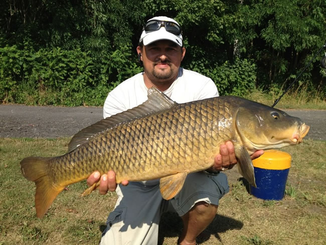 Tamas Vegvari with a 17.1 lb common from the July 8 CNY Summer Shootout in Fulton, NY