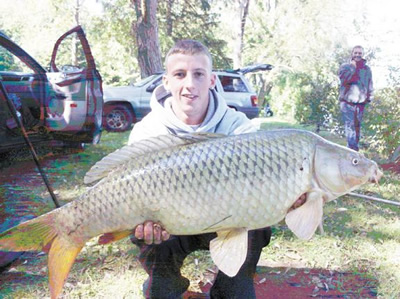 Sean Lehrer displays a nice 18 lb. 6 oz. common carp caught during Session four of Wild Carp Club, which was formed as part of Wild Carp Companies