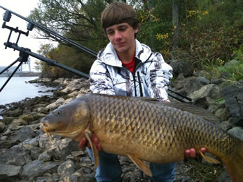 Club Director Michael Cummings with a common carp caught from the St. Lawrence River in Upstate NY