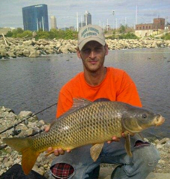 Club director Justin Keaton with a common carp caught in Indiana