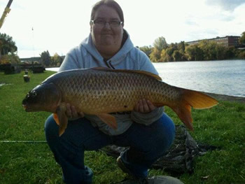 Sam Reid with her first ever carp, caught during Fall 2011 in Fulton, NY