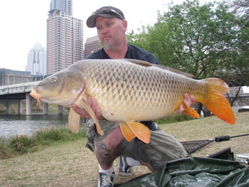 Scott Ferguson with a 34 lb, 8 oz common carp