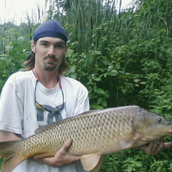 WCC of Ontario Director Brian Brown with a common carp caught in Ontario, Canada