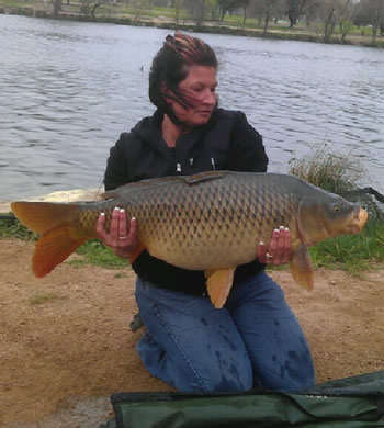 Wild Carp Club of Indiana Director Christine Stout with a common carp