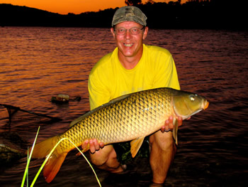 Wild Carp Club of Austin Director Keith Thompson enjoys a beautiful sunset with a common carp.
