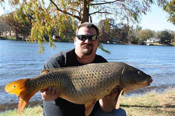 Wild Carp Club of North Texas Tournament Director Rick Wilson with a common carp